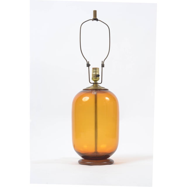 """A lovely """"wheat"""" colored blown glass Blenko lamp by Don Shepherd who designed for Blenko from 1974-1988. The lamp features..."""
