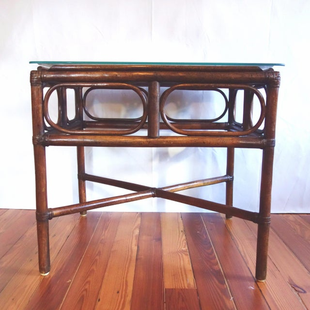 What a wonderful Palm Beach style bamboo end table with a glass top that will work with many decor styles including boho,...