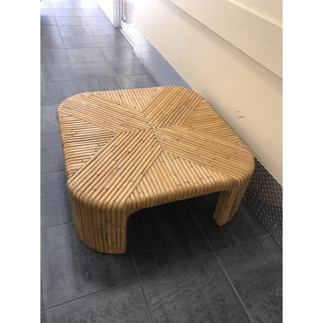 Gorgeous split reed square coffee table done in the style of Gabriella Crespi. It is entirely made of rattan reeds. This...