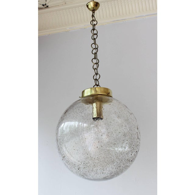 """A gorgeous Murano glass globe with gold flecks and brass details. 17 in chain shown. 4"""" ceiling CAP shown. 2"""" brass globe..."""