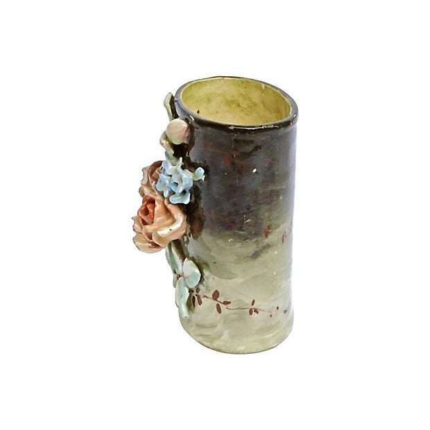 Antique; 19th century, hand-painted, French, Majolica, floral vase with hand-painted flowers and leaves in relief on the...