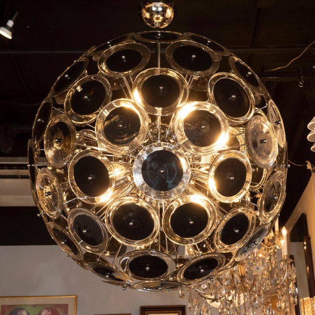 This dramatic and graphic vistosi sputnik chandelier was handblown in Murano, Italy, the islands off the coast of Venice...