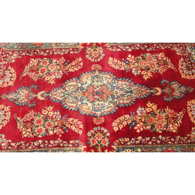 A stunning, very fine, wool pile, vintage Persian Lavar Kerman rug. It is hand woven and features gorgeous ornate, floral...