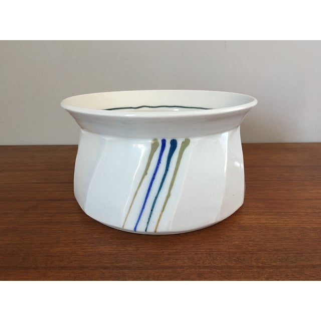 Vintage studio pottery bowl. Signed on bottom by the artist. Great design featuring a simple color palette and sleek...