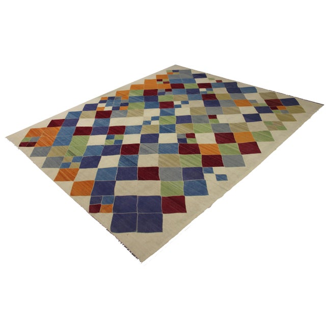A beautiful modern kilim, handmade by Aara Rugs. Geometric multi color design, that will look great in any room. This...