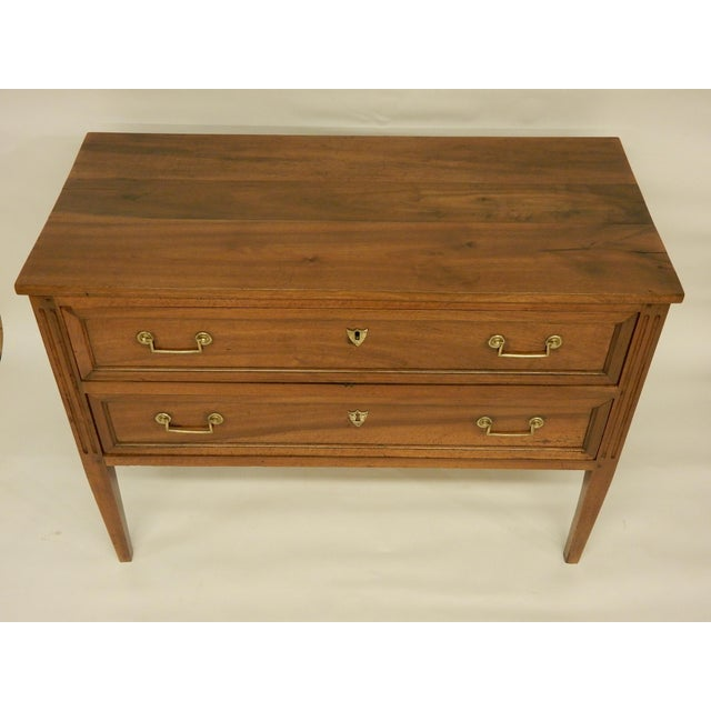Very nice 19th century Louis XVI style walnut two drawer commode. Carefully restored, structurally sound.