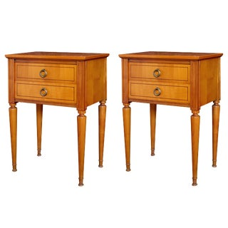 A stylish pair of French mid-century modern sycamore 2-drawer bedside cabinets