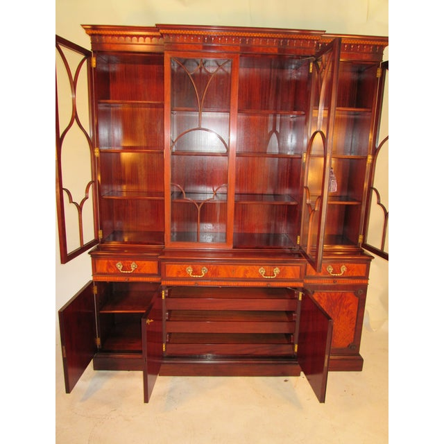 This is a fantastic breakfront made by Schmieg and Kotzian of New Your city. The case is made of mahogany with crotch...