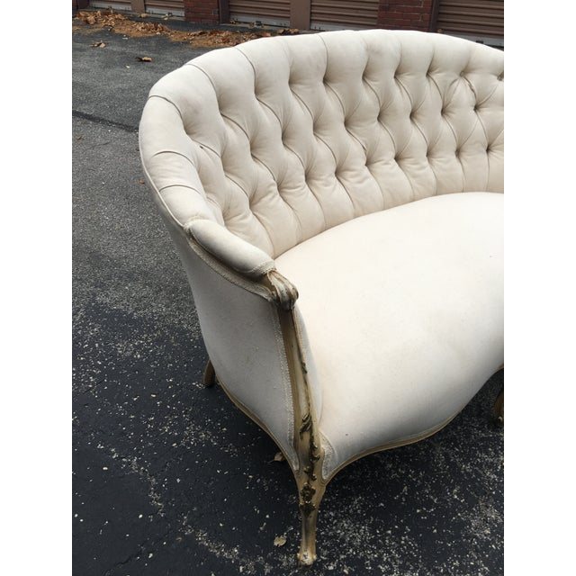 Fine 1920s tufted French settee with contemporary muslin covering. The legs and decorative arm strips of wood have been...