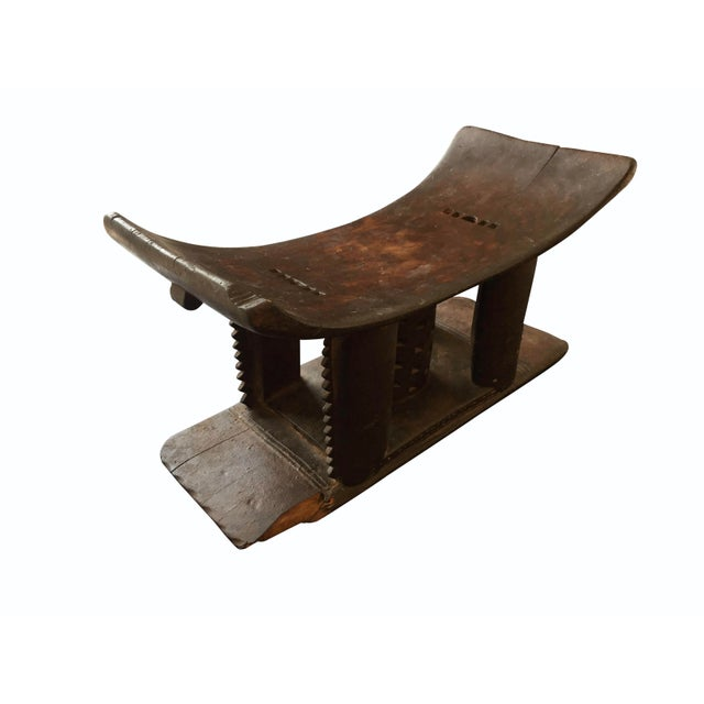 19th century Asante stool. Hand carved from a single piece of wood. This design was specifically carved for a woman,...