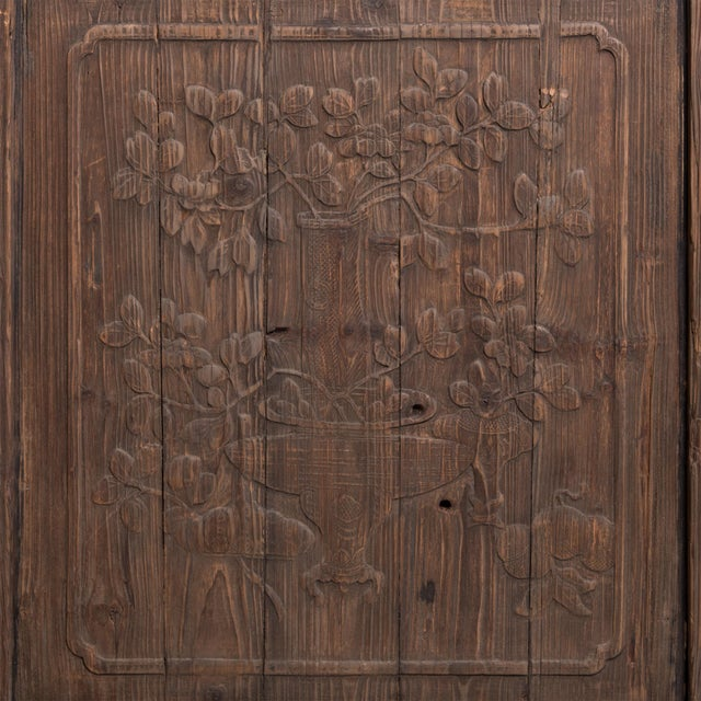 It's difficult to pinpoint what makes this handcrafted panel so impressive: the artful relief carvings of seasonal fruit...