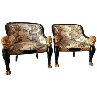 Lion Head Rest Ebonized Hollywood Regency Armchairs - A Pair For Sale