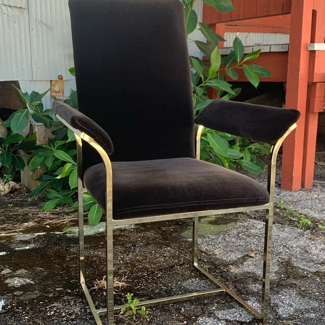 Full set of 8 Milo Baughman-Style dining arm-chairs by Cal-Style in black upholstery with gold metal frames. Chairs...