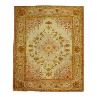 Ivory and Pink Antique Turkish Oushak Rug For Sale