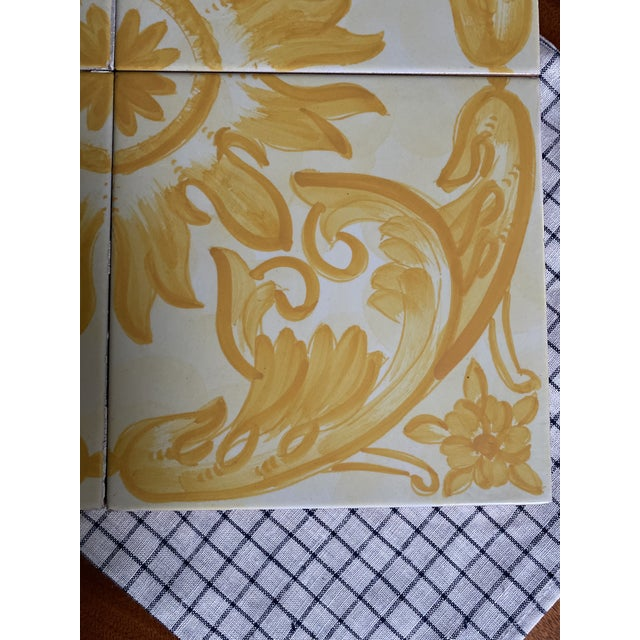 Beautiful set of 4 Italian tiles from the 1960's. Hand painted yellow and white motifs. I have two of these sets...