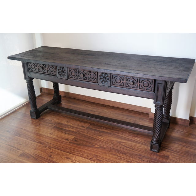 18th Spanish Baroque Carved Walnut Refectory Table Its carved on the front (drawers) and back. Beautiful legs. Completely...