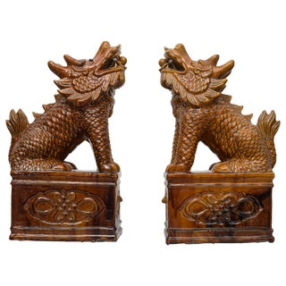 Chinese Umber Glazed Porcelain Foo Lions - a Pair For Sale