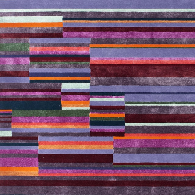 A contemporary staggered stripe, this colorful design is as practical as it is stylish. A hand-tufted construction of wool...
