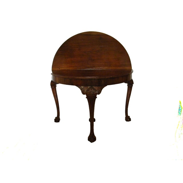 Late 19th century English demi-lune table with a flip top to make round table. It is on four carved legs. Opens to 44...