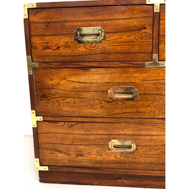 On trend vintage Bernhardt Campaign Chest of Drawers. Seven drawers for versatile storage. There is some wear consistent...