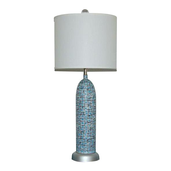 A unique offering. A pair of bullet shaped vintage Italian table lamps with a whimsical squiggle design and matching three...