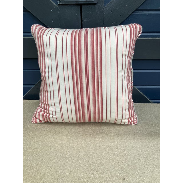 A pillow made from a circa 1950's floral polished cotton. Backed and trimmed with red and white vintage cotton ticking...
