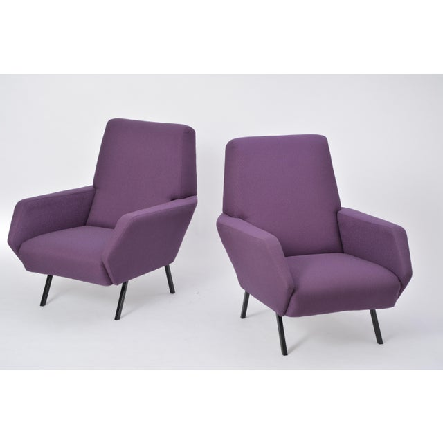 These lounge chairs were produced in Italy in the 1950s. They have been completely reupholstered in purple fabric and the...