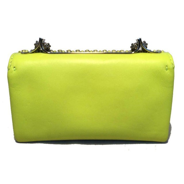 Valentino Garavani Va Va Voom Neon Studded Knuckle Clutch with Strap in excellent condition. Neon yellow/lime green...