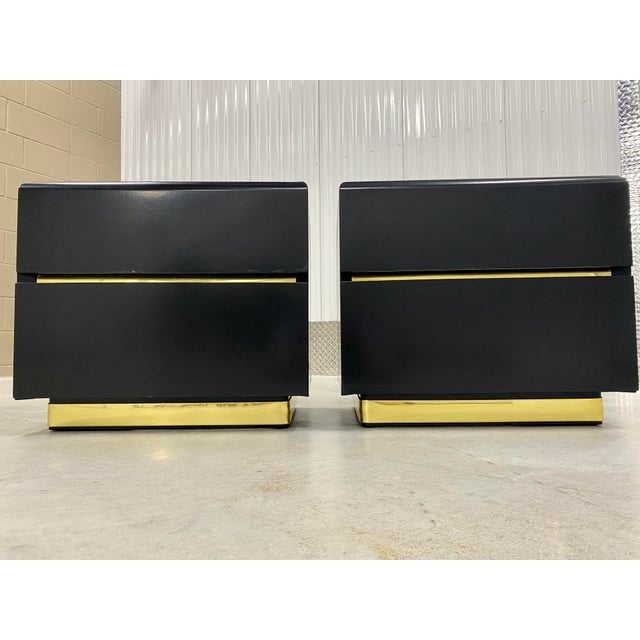 Mid-century lacquer finished nightstands or side end tables. Features a high-gloss black finish with smooth, rounded...