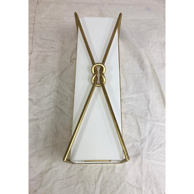 Ariadne wall sconce by Currey and Company. This light was a showroom sample. Very light wear. The sconce measures 6 inches...
