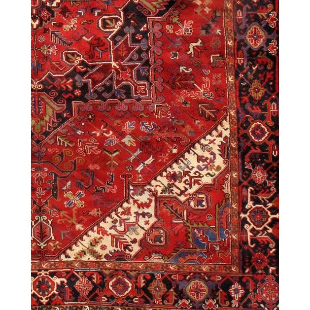 Hand-knotted Heriz rug. These rugs feature 100% fine pure lambs wool, hand-knotted on a cotton foundation into elegant...