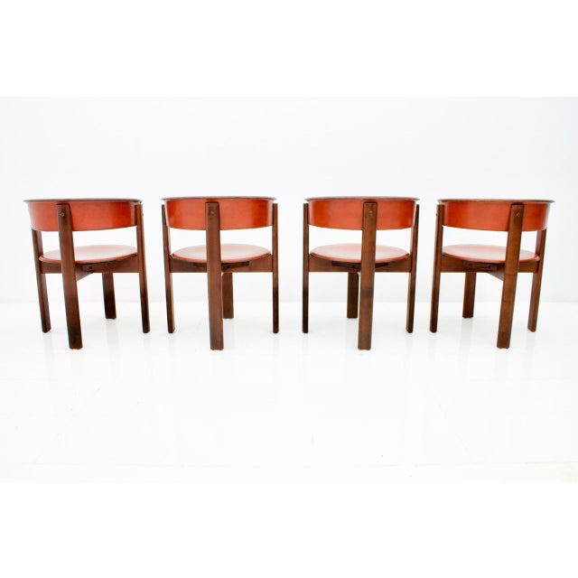Set of four leather and walnut dining room chairs by Cassina, Italy. High quality. Good original condition. Worldwide...