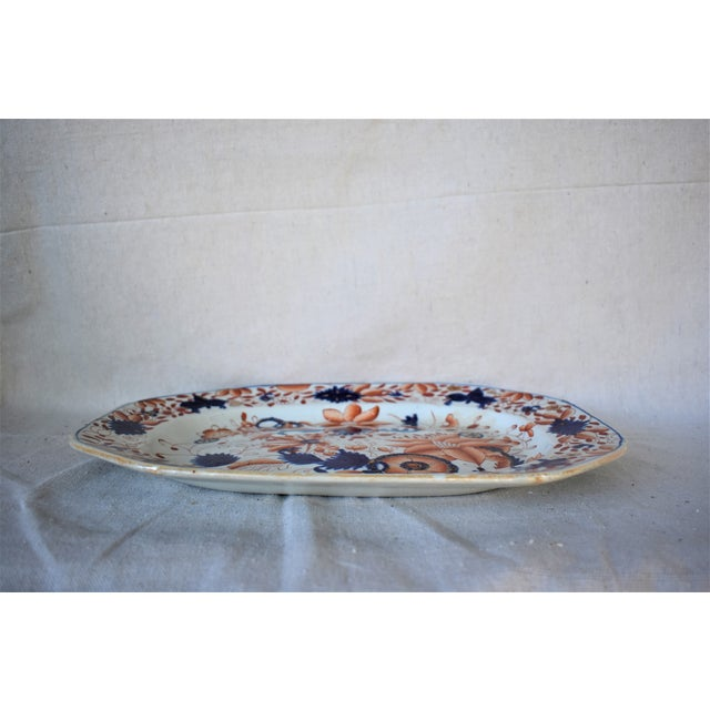 Antique Mason's Ironstone platter decorated with flowers and wheels executed in rust and cobalt blue. This is a rare...