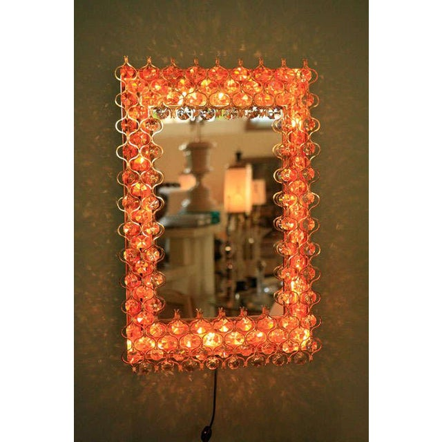 Beautiful rectangular Lobmeyr backlit mirror surrounded in crystals & gold. New electrical.