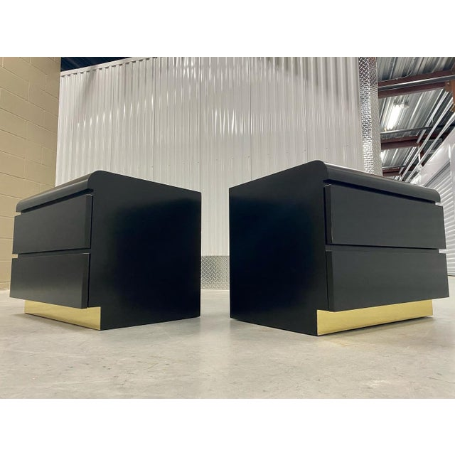 Restored Glossy black lacquer, paired with bright brass accents side tables. These beauties and big for end tables with...