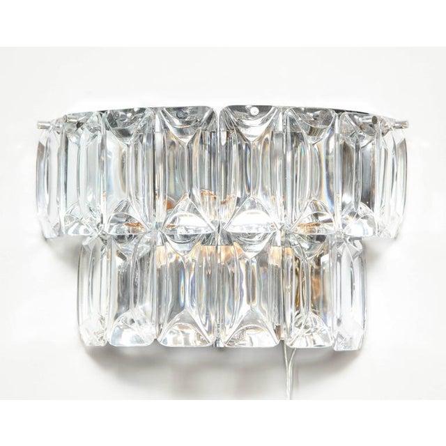Modern Austrian crystal sconces.