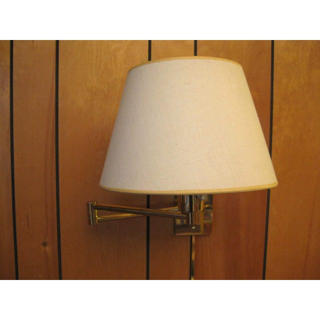 Designed by George W. Hansen in 1947 while devising a reading lamp for his bunk during World War II. This vintage pair of...