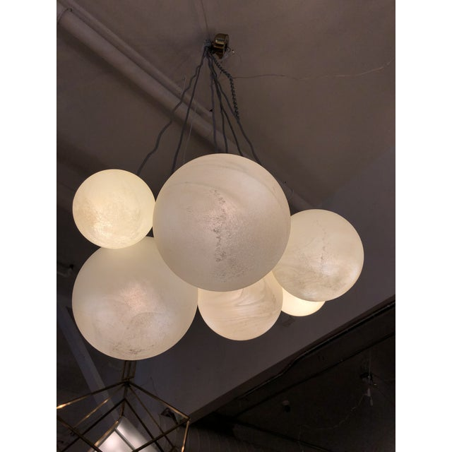Design Plus Gallery presents a Zenith Chandelier by West Elm. A shoot for the stars, consists of six lunar-inspired glass...