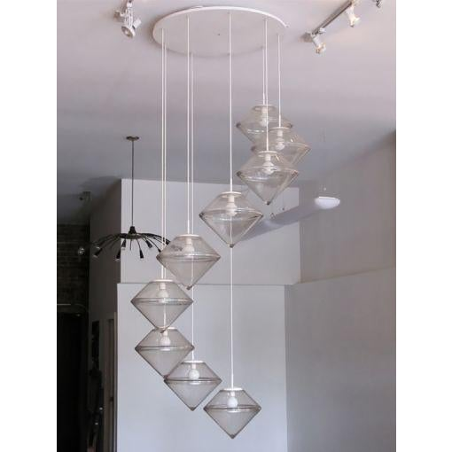 Monumental chandelier comprised of nine clear acrylic cascading forms, large circular canopy in enameled metal