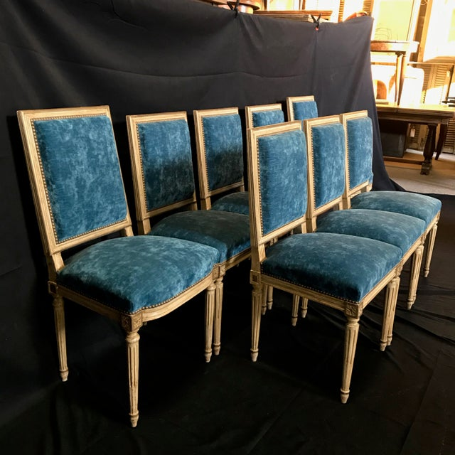 Stunning and complete set of 19th century Louis XVI dining chairs from Lyon, France having sumptuous blue velvet...