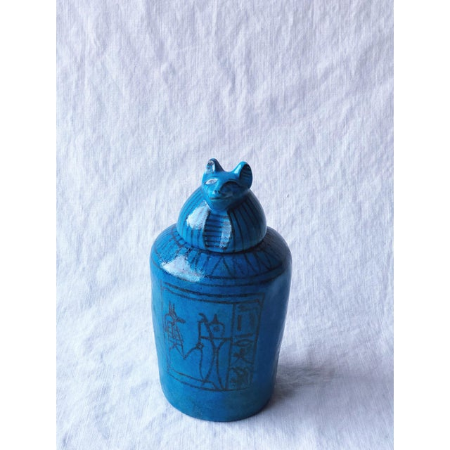 This is a beautiful, rare Egyptian reproduction canopic container made by Metrolpolitan Museum of Art in a gorgeous blue...
