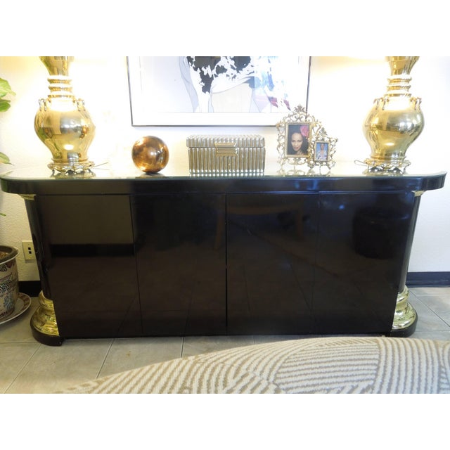 Attributed to Mastercraft, is this custom ordered 4 door sideboard with rounded corners anchored by thick, beautiful,...