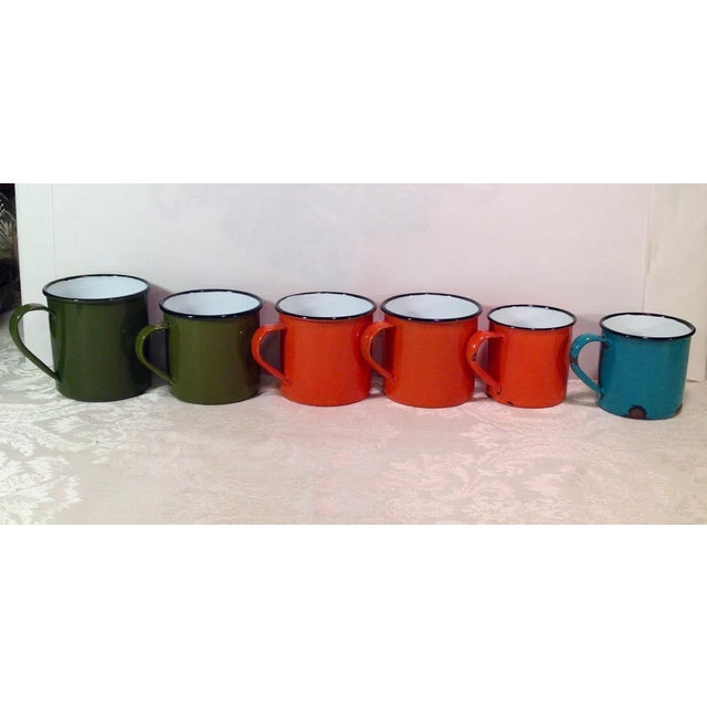 Nice set with various sizes shown below. Great mid Century colors! Measurements of large green cup W-4.5 D-3.5 H-3.5...