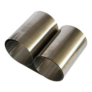 Mid Century Modern Brushed Steel Roll Up Book Ends For Sale