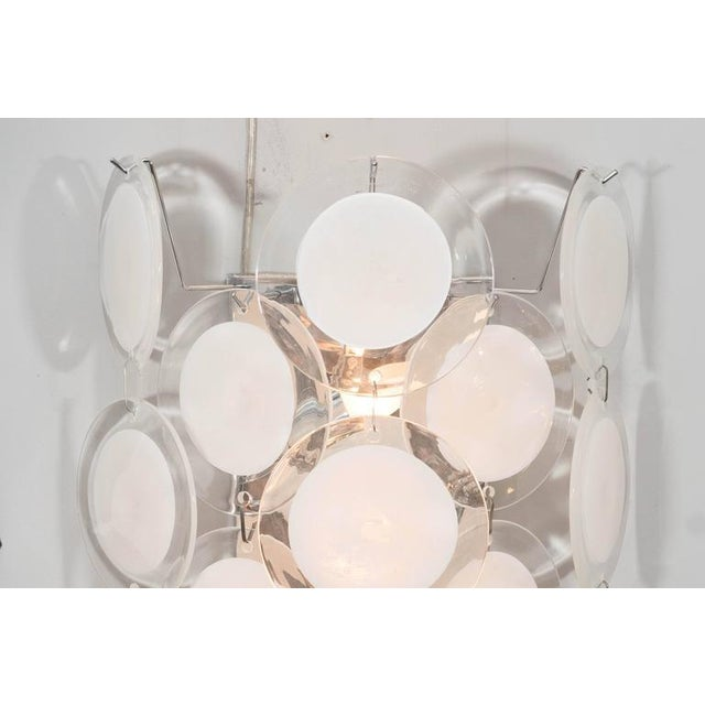 Pair of Murano glass disc sconces in white.