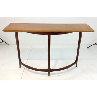 Mid-Century Modern Style in Curve II Console Table By: Theodore Alexander Preview