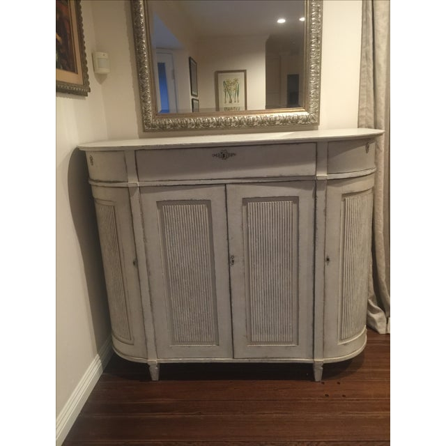 Purchased from H.D. Buttercup, this is an excellent buffet table for storage. You can put it at the end of a dining table...