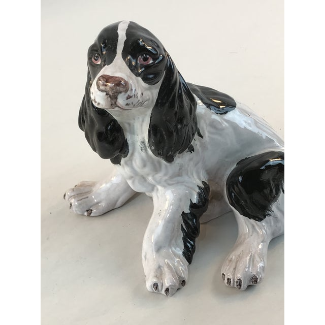 Vintage terra cotta majolica spaniel from Italy. A fun styling piece!