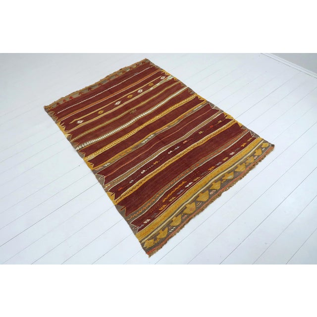 This beautiful striped and embroidered rug from westhern of turkey. Oushak nomads kilim weaved with traditional turkish...