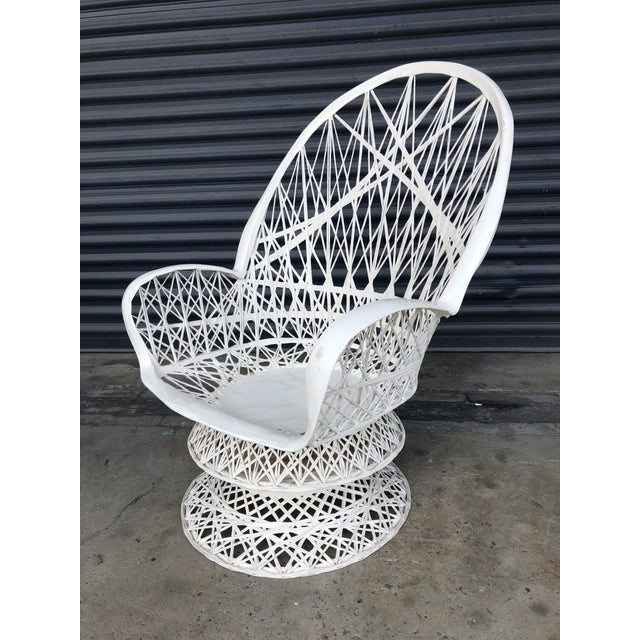 Vintage spun fiberglass swivel lounge chair. A perfect Palm Beach regency accent for your patio. Sold without cushion....